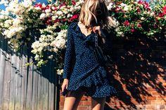 Shop wrap dresses with CHRONICLES OF HER. Carmen Hamilton wears Realisation Par navy star wrap dress, Proenza Schouler bag from MATCHESFASHION.COM.