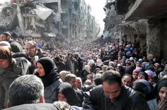 Syria War - this picture taken on Jan. and released by the United Nations Relief and Works Agency for Palestine Refugees in the Near East (UNRWA), shows residents of the Palestinian camp of Yarmouk queuing to receive food supplies in Damascus, Syria. Syrian Refugee Camps, Syrian Refugees, Syrian Civil War, Refugee Crisis, Refugee Status, Spiegel Online, Paris Match, Destin, United Nations