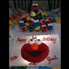 Elmo and friends cake and cupcakes for Ella and Jonah's 1st birthdays...