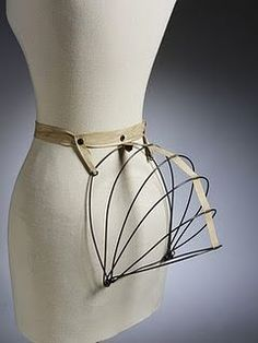 Home made bustle.  Made this, it really works.  Here is the url for the tutorial.  http://motleymaker.blogspot.com/2010/12/1884-collapsible-wire-bustle.html