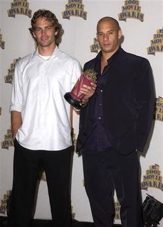Paul Walker and Vin Diesel attend the 2002 MTV Movie Awards at The Shrine Auditorium in Los Angeles on June 1, 2002.