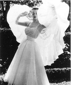 Capucine wearing a gown by Hubert de Givenchy, 1952.