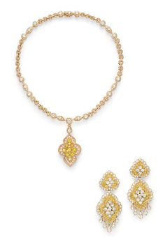 A SUITE OF COLORED DIAMOND JEWELRY, BY VAN CLEEF & ARPELS. Comprising a pendant necklace, suspending a detachable circular-cut yellow diamond and diamond and gold ropework cartouche, from the pear-shaped diamond surmount and openwork circular link gold chain, spaced by triple-row diamond spacers; and a pair of ear pendants en suite, mounted in 18k gold, necklace 13¾ ins., with French assay mark and jeweler's mark for Van Cleef & Arpels. Signed Van Cleef & Arpels, nos. 30525, 30354 and 28937.