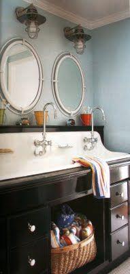 Trough sink set into a vanity cabinet