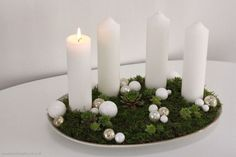Moss, succulents and pearls make an elegant and unusual Advent wreath.