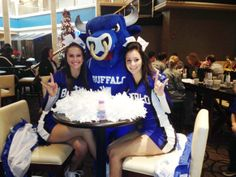 Our lovely cheerleaders throwing those #HornsUp with Victor E. Bull! #BowlingBulls #uBuffalo #UBBulls Join us at: http://www.buffalo.edu/goubbulls.html