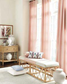 Rattan wicker bench in pink bedroom designed by Suzanne Kasler for Ballard Designs #bedroomdesign