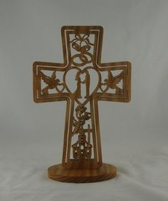 What a wonderful wedding gift to give is this unique wedding cross. Nestled inside the cross is bells, rings, doves,hearts, bride, groom, flowers, cross, and a church. This is sure to be the best gift