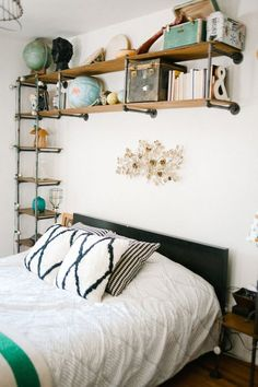 Bedroom shelving with vintage globes (cat climbers, too)