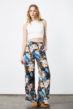 Black and Blue Floral Print Flare Pant   Soul Escape With floral prints and 70s fashion in high demand, make a statement that shows you follow only the best trends and know how to accentuate your figure in these striking pants.