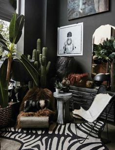 DARK BOHEMIAN elements eclectic mix of furnishings - Butterfly chair, hand-carved wooden side table, metal? lounge chair, ledge w/ lots of carved Room Inspiration, Interior Inspiration, Dark Bohemian, Wooden Side Table, Side Tables, Dark Interiors, My New Room, Elle Decor, Home Interior Design