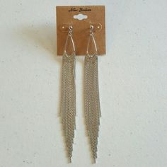 Long Drop and Dangle Silver Color Earrings Metal color is silver and earrings are post back. Length of earrings is 5 inches and 1 centimeter long. Jewelry Earrings