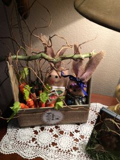 Another Pinterest inspired project.  Foam core frm dollar store, brown wrapping paper, paint, and twigs n branch frm brother in law.  My version of rabbits frm Pinterest.