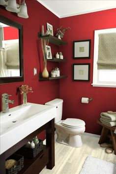 Color Caliente for the half bath have a storage vanity and chrome and dark wood acessories