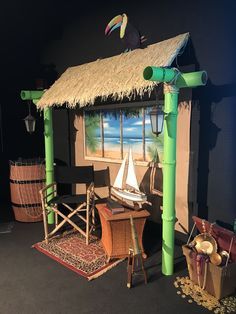 """2018 Shipwrecked VBS stage decorations - my diy tiki hut, treasure chest from a foam cooler and """"wooden"""" barrel from a cardboard box."""