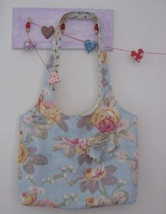 Make this bag from 1/2 yard.  The tutorial is here:  http://mollychicken.blogs.com/my_weblog/2009/06/half-yard-bag-part-1.html
