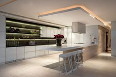 penthouse saota  - integrated and seamless - such an awesomely well designed open plan kitchen.  The luminated, floating bulkhead brings more depth and life