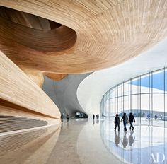 Set on the Songhua River in northeast China, this venue is the latest wonder from Ma Yansong, whose firm has earned a reputation for arresting, futuristic formmaking. The building consists of two gently sloping volumes that suggest snowdrifts or icy mountains, an impression reinforced by a swirling skin of white aluminum. Inside, expanses of timber reminiscent of alpine huts lend warmth to the sleek structure.