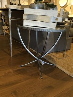 Round side table with nickel finish and antiqued mirror top, 24 13/16 D x 24 1/4 H - $895