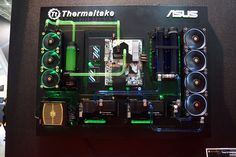 Thermaltake and ASUS combine on this wall mounted system, with two separate water loops for the CPU and the two GPUs, each loop with their own color. Gaming Pc Build, Computer Build, Gaming Pcs, Wall Computer, Gaming Computer, Gaming Room Setup, Pc Setup, Pc Gamer, Custom Pc Desk