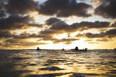 INCREDIBLE photo of some surfers.  Taken by fotography87 (on flickr)