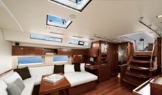 Beneteau Oceanis 55: This image shows the expansive use of Alpi mahogany in the salon and galley.