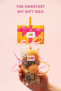For an extra sweet gift card DIY, fill a Dunkin' cup with munchkins', top it with a gift card, and add some ribbon for a festive touch. Start gifting now at DunkinDonuts.com.