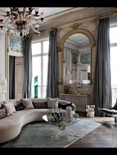 Renovated Paris apartment...various shades of the soft duck egg blue against the curvaceous sofa..