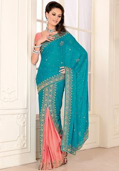 Turquoise blue and peach faux satin chiffon lehenga style saree designed with stone and cutbeads work. Available with peach faux satin chiffon blouse fabric.