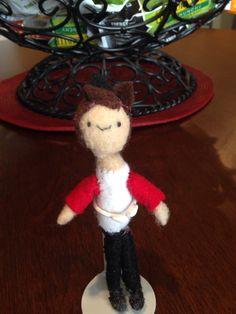 This is a cute miniature plush doll.