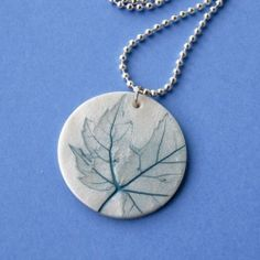Really inexpensive project - just use polymer clay and bots of nature to create a one-of-a-kind pendant!