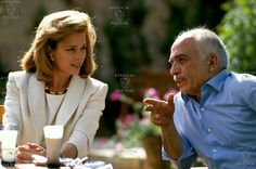 King Hussein enjoys a rare moment of relaxation with Queen Noor of Jordan.