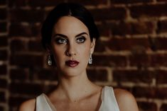 2018 Moody Glam Edgy Bridal Makeup Look Makeup and Hair by Katie-Laine Thornton Gown and Jewelry: Modern Trousseau Nashville Photography: Wilde Company Model: Erin Belle