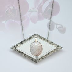 Ethereal centered for a powerful silhouette... Sugi pendant by Zignia Design, photo credit Omitsu Issey