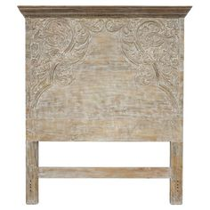 Showcasing hand-carved detailing and a weathered lime wash, this mango wood headboard adds a vintage-inspired touch to your master suite or guest room.