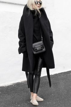 winter outfit inspiration - black cocoon caot, leather leggings and black sweater