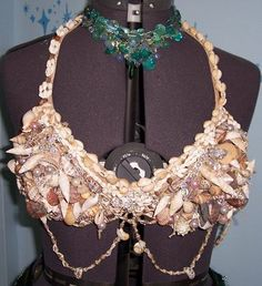 Erika's Chiquis: Mermaid Shell Bra I have a tutorial on how to make this on my blog. Mermaid Fin, Mermaid Tails, Mermaid Shell, Breast Cancer Bras, Shell Bra, Ordinary Girls, Tribal Fusion, Belly Dance Costumes, Seashell Crafts