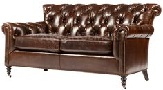Brown Tufted Loveseat   With its supportive arms and deeply tufted upholstery, this loveseat is synonymous with comfort. Our leather loveseat retains all the fine points of the Edwardian originals, creating furniture that's perfect for relaxing.