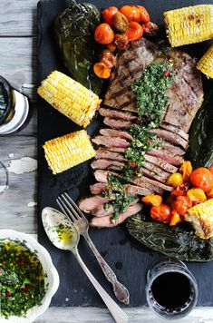 I call this a beautiful meal. Inspired by Argentinian cuisine,this juicy and tender marinated flank steak is served with our homemade chimichurri sauce. This recipe is perfect with roasted poblanos, heirloom tomatoes and sweet corn. via This Cook That Grilling Recipes, Beef Recipes, Yummy Recipes, Savoury Recipes, Savoury Dishes, Recipies, Jerk Recipe, Recipe Box, Recipe Ideas