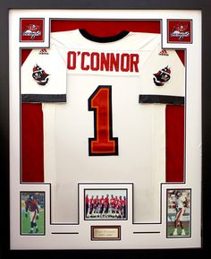 Football Jersey displayed with custom cut openings for photographs, patches, and a personalized plate.  Designed and framed at Art & Frame Express, NJ.
