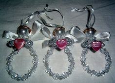 These are very pretty beaded angel ornaments/dangles with pink hearts. I made them out of various plastic beads and pearls, white pipe cleaners,