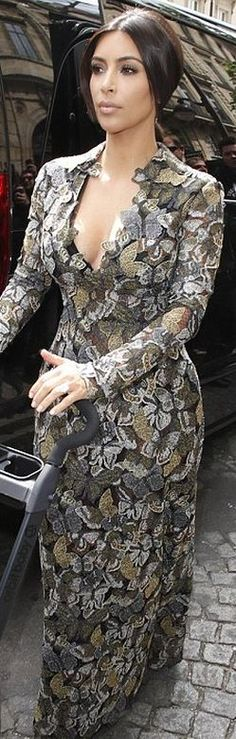 Who made  Kim Kardashian's gray suede pumps and butterfly long sleeve print gown that she wore in Paris?