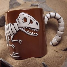If you are a fan of the Jurassic films and waiting patiently for the new Jurassic World film why not look at some of these Jurassic Park gift ideas. Coffee Cups, Tea Cups, Dinosaur Mug, Cool Mugs, Cool Items, Mug Cup, Mug Designs, Tea Set, Cool Gifts