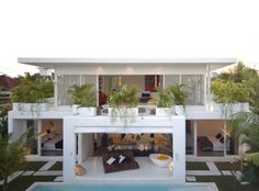 Architecture, Fabulous Contemporary Duplex House Design With Patio Beside Outdoor Pool With Lush Vegetations Set Around It To Refresh The Entire Part Of Home Building: Contemporary Duplex House Design with Stylish Open Space Concept