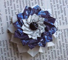 Heather of Rhymes With Magic shows how to fold a paper dahlia brooch step-by-step.