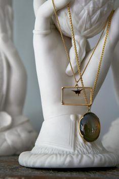 Gabriella Kiss designed pendants and chains draped over Parian ware hands - T Magazine