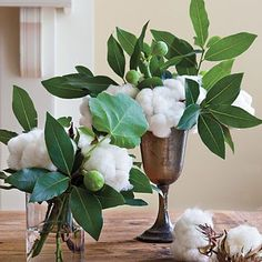 Create a centerpiece with a twist by using cotton bolls instead of flowers. Add fig and bay branches to give your arrangement a touch of green.