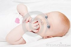 Cute Baby Girl Sucking Her Fingers -  on White Background