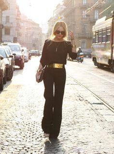 elegant + all black + gold belt + classic chignon
