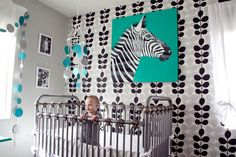 iron crib, black and white, pops of green, vintage and modern together - jewel tone green for nursery. Crib available from Palm Beach Tots #zebranursery #blackandgreennursery